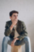 man-wearing-a-jacket-sitting-on-brown-wo