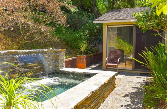 Vast Backyard with Waterfall