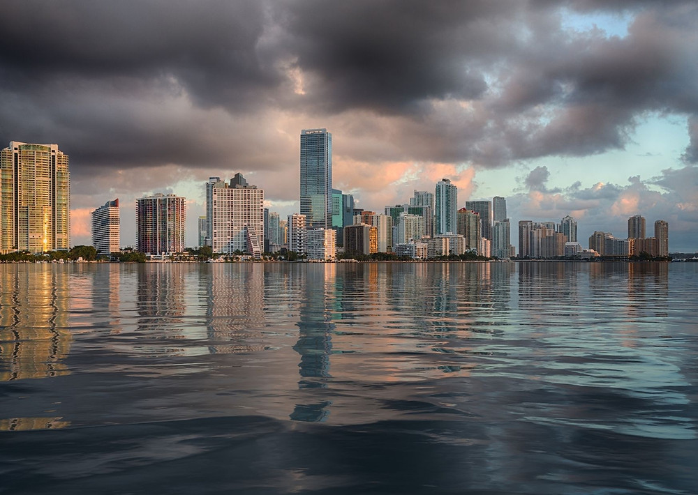 Sea Level Rise in South Florida can be mitigated through Everglades Restoration and climate change mitigation