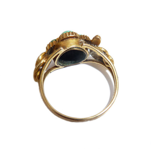an antique gold turquoise and diamond ring in the form of a flower with snake shoulders size 2 d i am using an antique band to get it to a size 6
