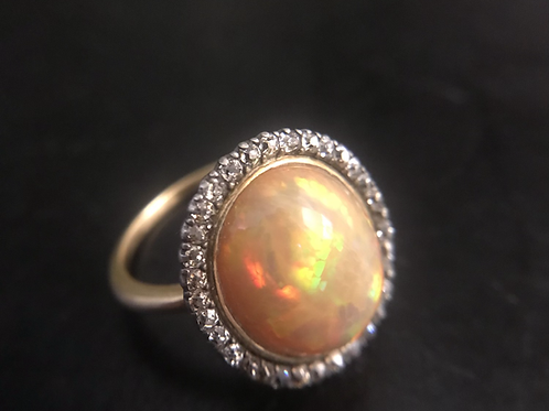 Vintage Jelly Opal Ring with diamond halo and 18  carat gold shank