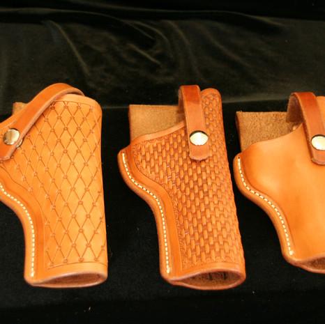 three holsters made by Aaron Fandek