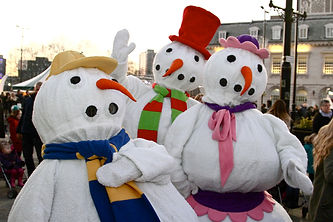 Faceless Snowmen Performance leading the Rochdale Christmas Parade