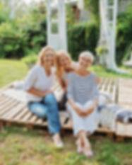 Three women enjoying outdoors, talking a