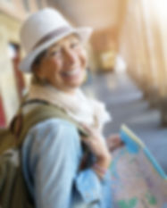 Senior woman traveling in european city,