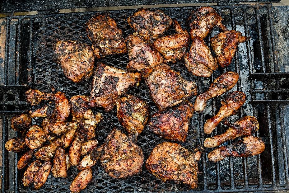 Chicken on the grill Jerk Caribbean Cuisine.jpg