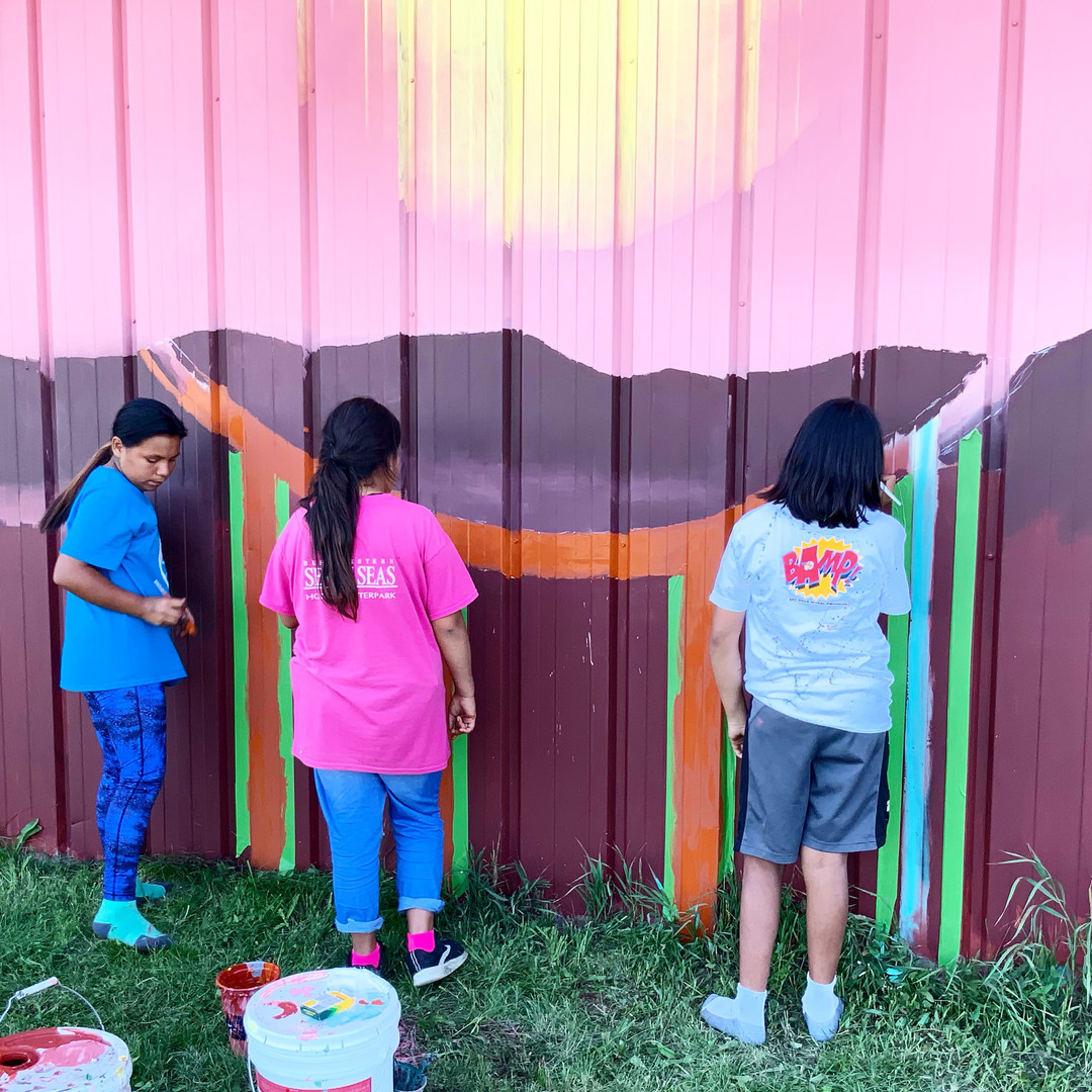 Sioux Nation Girls help paint