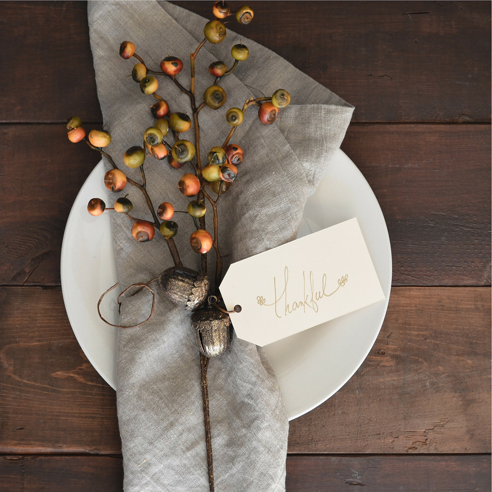 "Thanksgiving flat lay on table with ""thankful"" written on a tag"