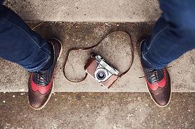 Schuhe und Kamera
