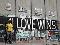 """Love Wins"" painted on apartheid wall"