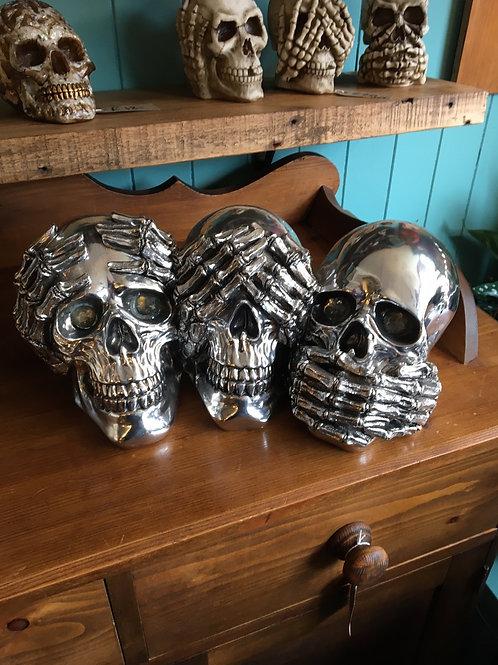 Silver see hear say no evil skulls