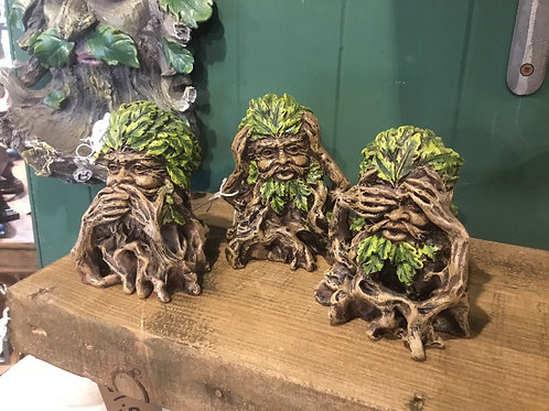 Green men see, hear, say nowt statues.