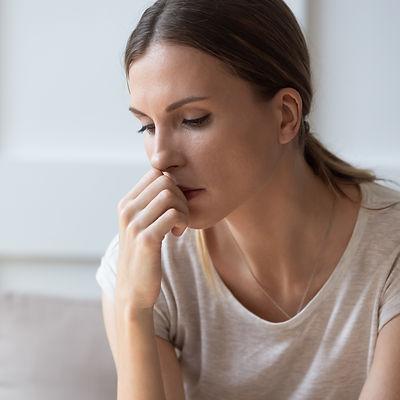 Close up of sad pensive millennial woman