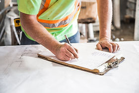 construction worker reconciling report