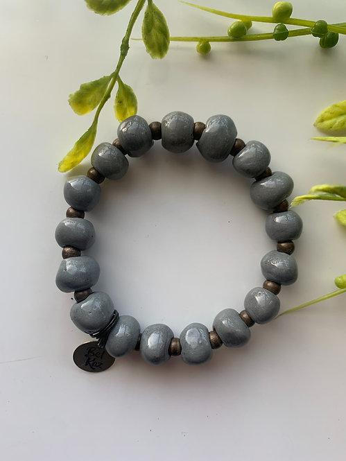 Grey (glossy), bracelet w/ brass stamped charm