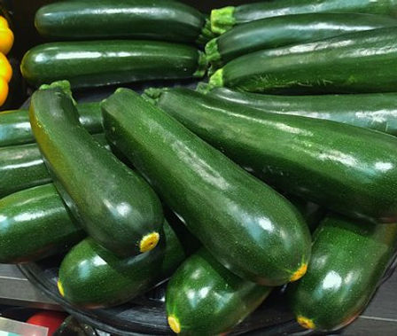 Here is the Black Beauty Zucchini,Cucurbita pepo.It is an heirloom summer squash prized for its crisp, white flesh and dark green skin. it dates back tothe 1920s andwas a 1957 All America Selections winner developed by John Scarchuk. They can range from a dark green to almost black in color and produces 6 to 8 inch long fruits. It has a great smooth flavor and best picked young. Plants are not a vine but can grow to 2 - 4 feet long.The fruits have a very long shelf life and can be stored for months! This variety of squash is great for frying and baking but we like to pickle the youngfruits in a pickling brine. Open pollinated, 70 to 80 days.