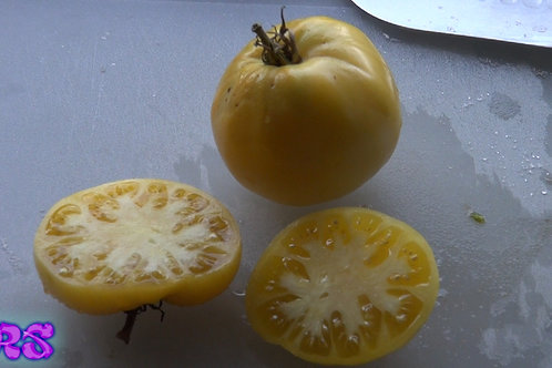 The Basinga tomato, PI 629218 is a Rare pale yellow tomato with a tinge of pink, heart shape, with a delicate flavor. An heir