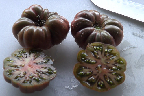 Here is the Purple Calabash Tomato , Solanum lycopersicum. This tomato originates from Mexico and it's history dates as far b