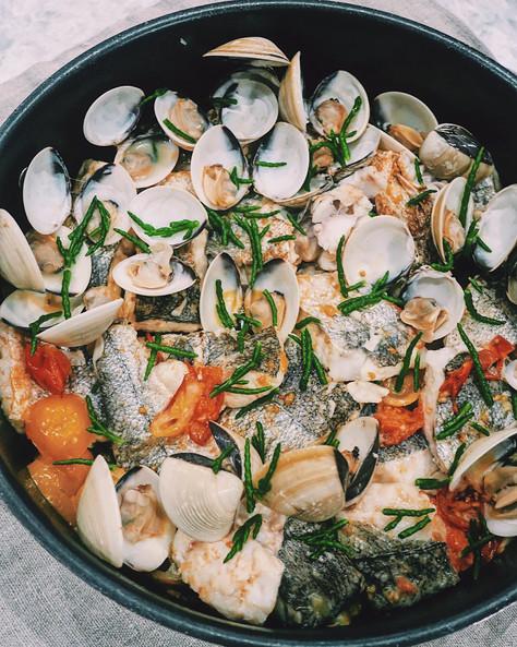 Cornish hake with wild samphire, vine tomatoes and clams