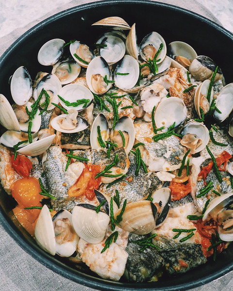 Cornish hake with wild samphire, vine tomatoes and clams