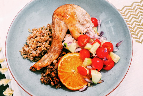 Roast chicken stuffed with spiced freekeh, pine nuts and orange