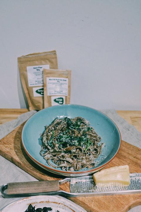 Acorn fettuccine with a creamy wild mushroom and spinach sauce