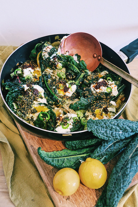 Winter greens shakshuka with goats milk labneh and za'atar