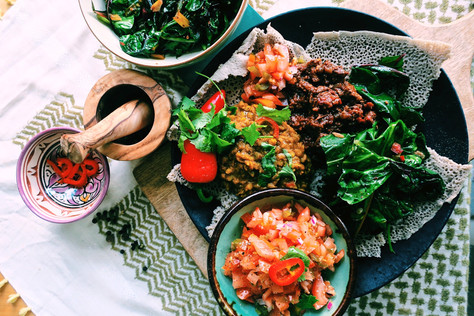 Ethiopian beef casserole with lentils, tomato salad and collard greens