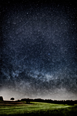 falling stars in the night of the new moon