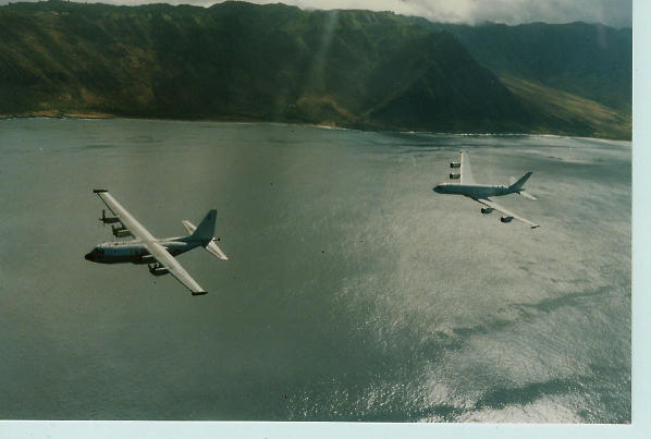 Last VQ-3 Herc Departs with Merc Escort