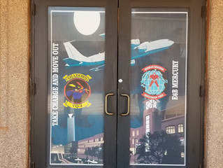 Entry way doors to VQ-4 spaces and VQ-3, Mercury Grill & ATM in Squadron