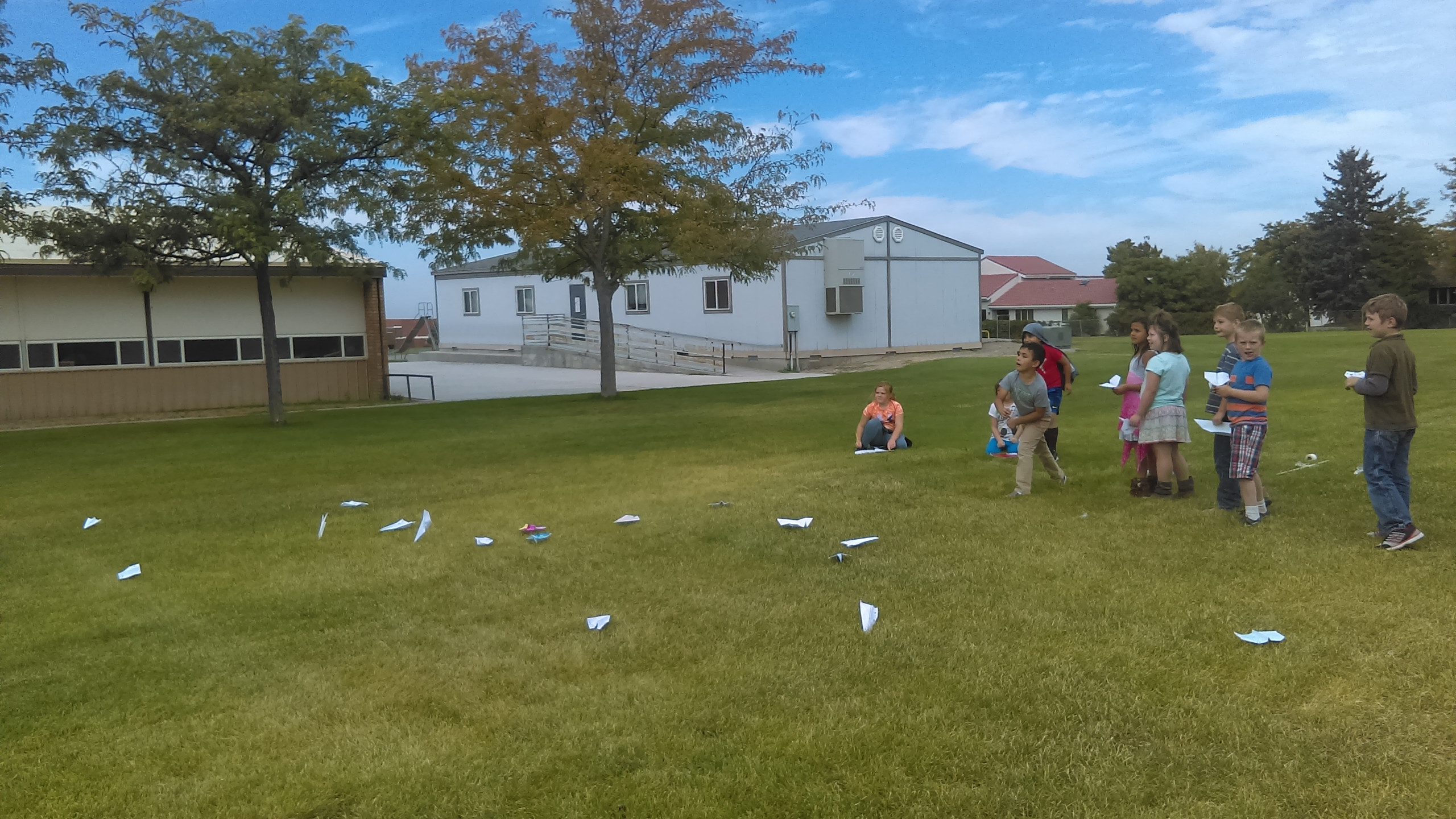 PES Students are challenged to make paper airplanes.