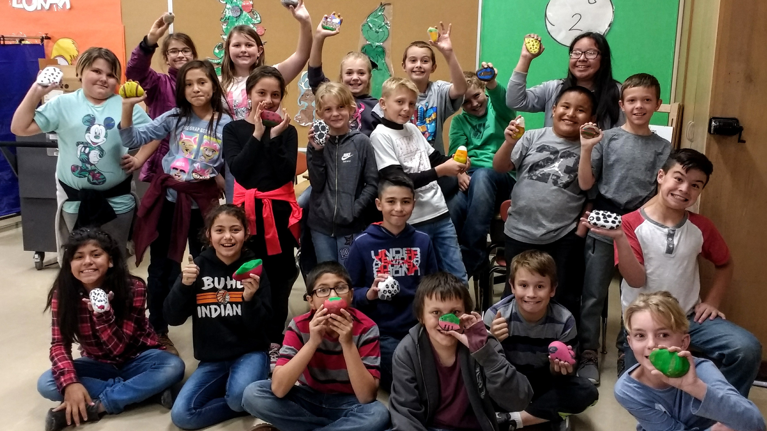 """5th Grade Students show off their painted rocks with the """"Thank a Farmer Day"""" theme."""