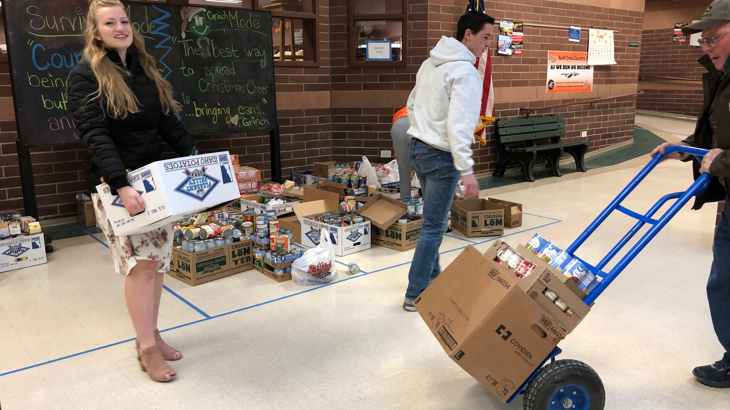 BHS Students completed the food drive and now they help load them away to help others.