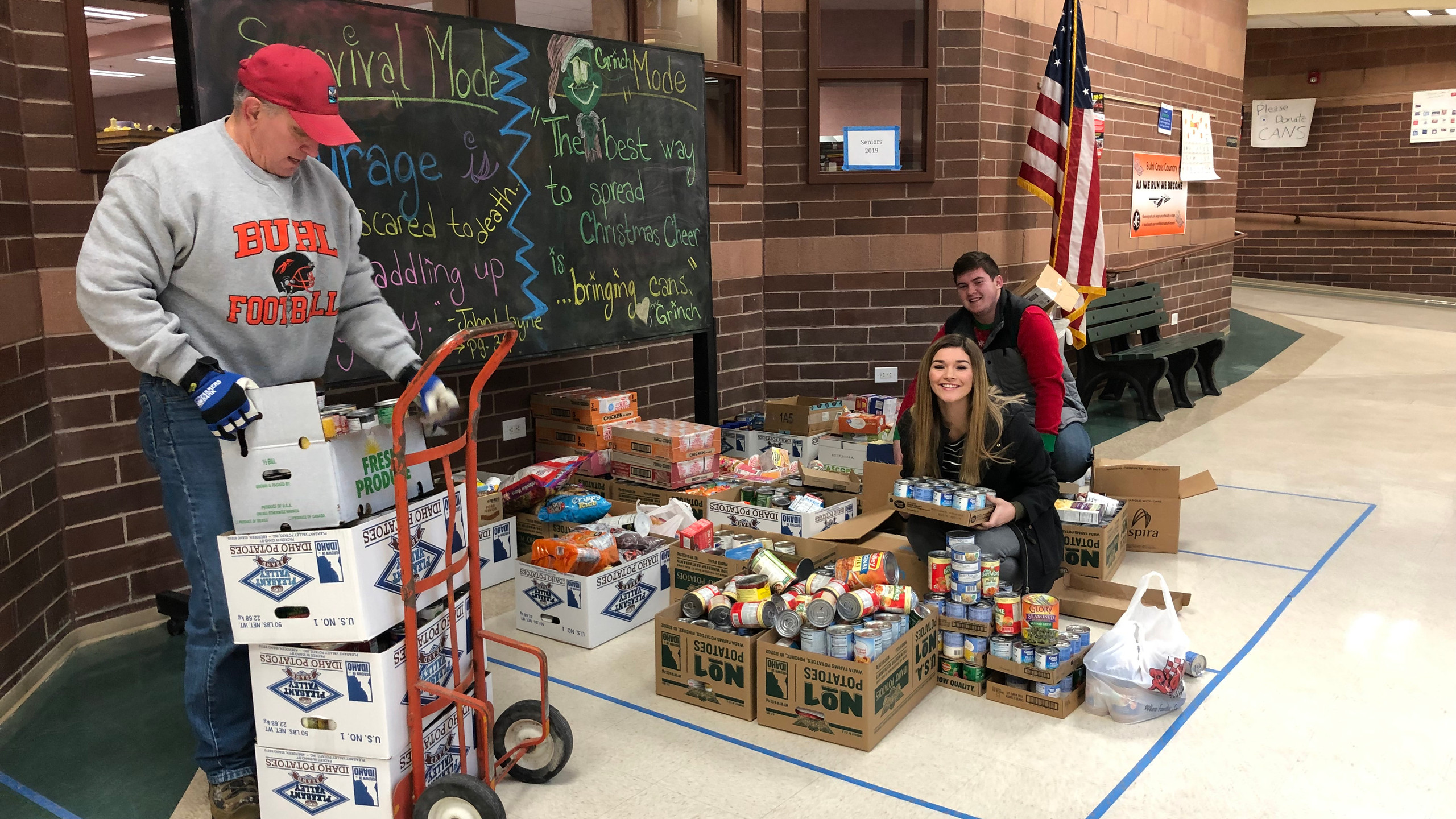 Students are helping load the cans from the food drive to be taken to places that will help those in need.