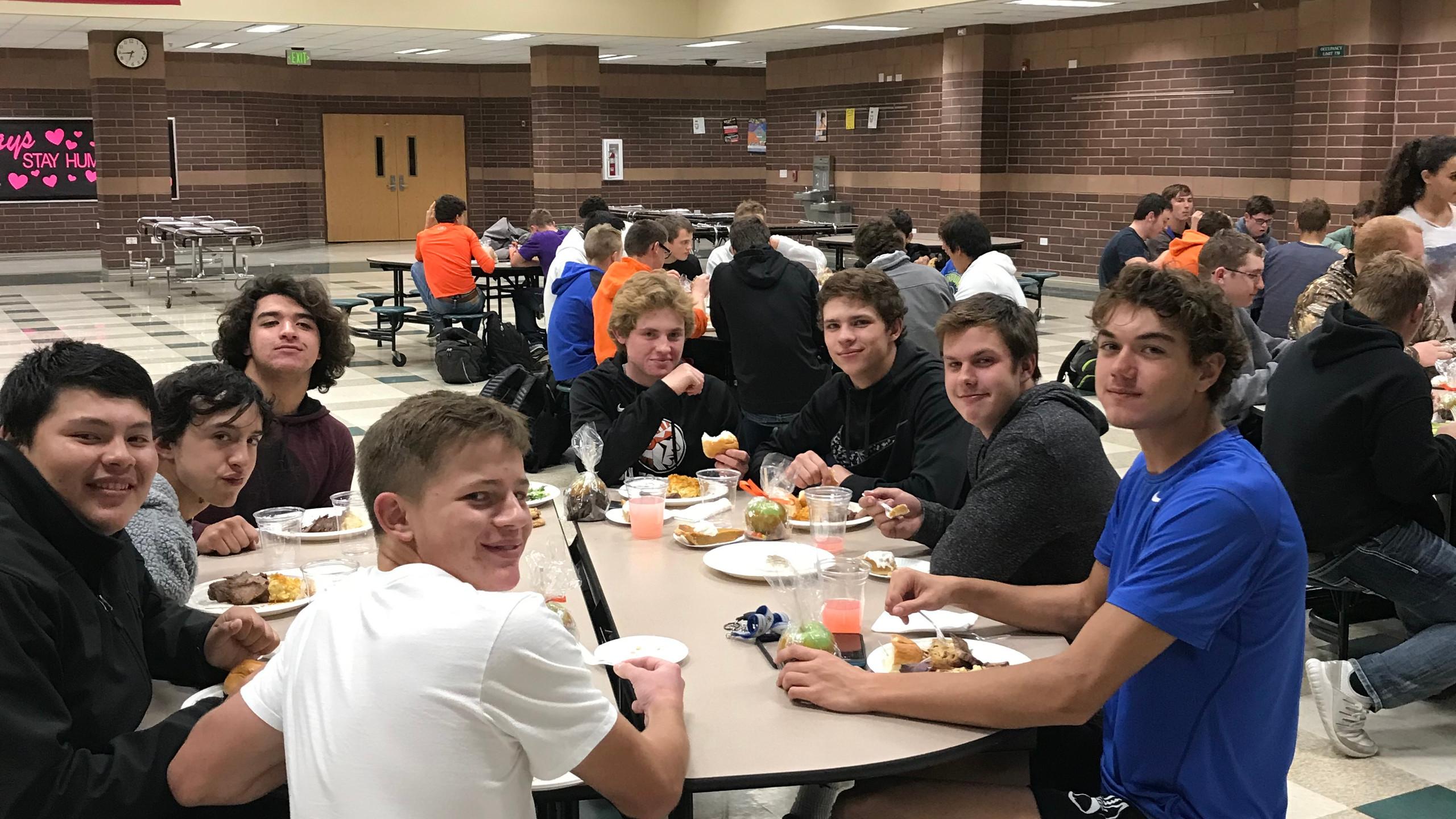 The Football boys enjoy a meal together for their Senior Night.