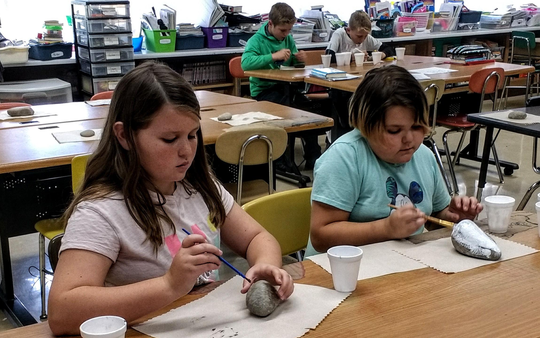 Hard at work! 5th grade girls get creative thanking a farmer with their design.