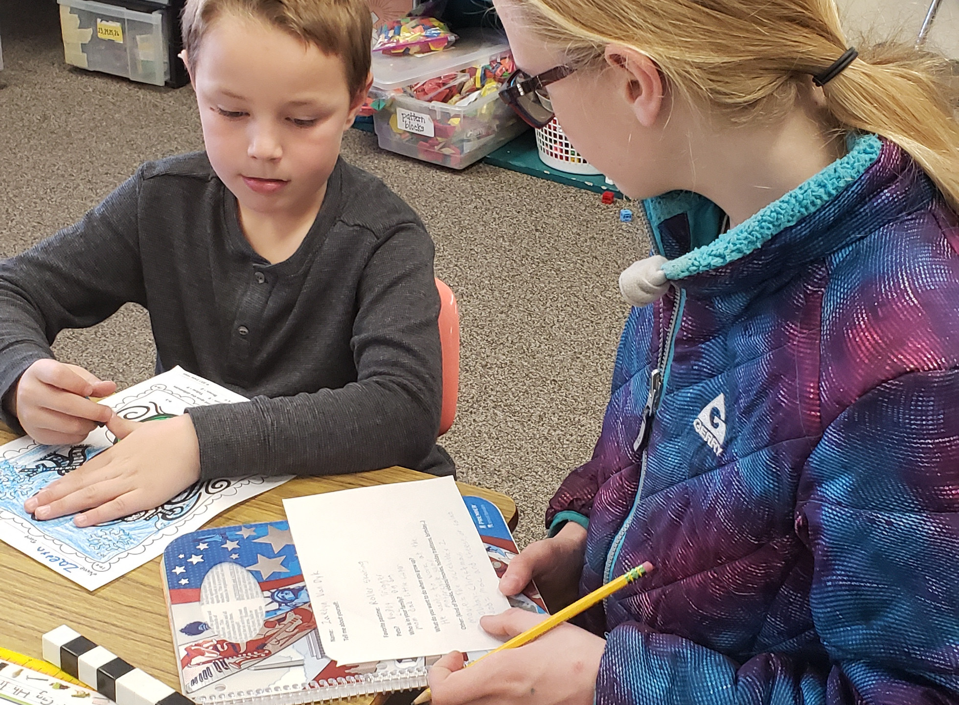 BMS Student works with a PES Student to create a Christmas story.