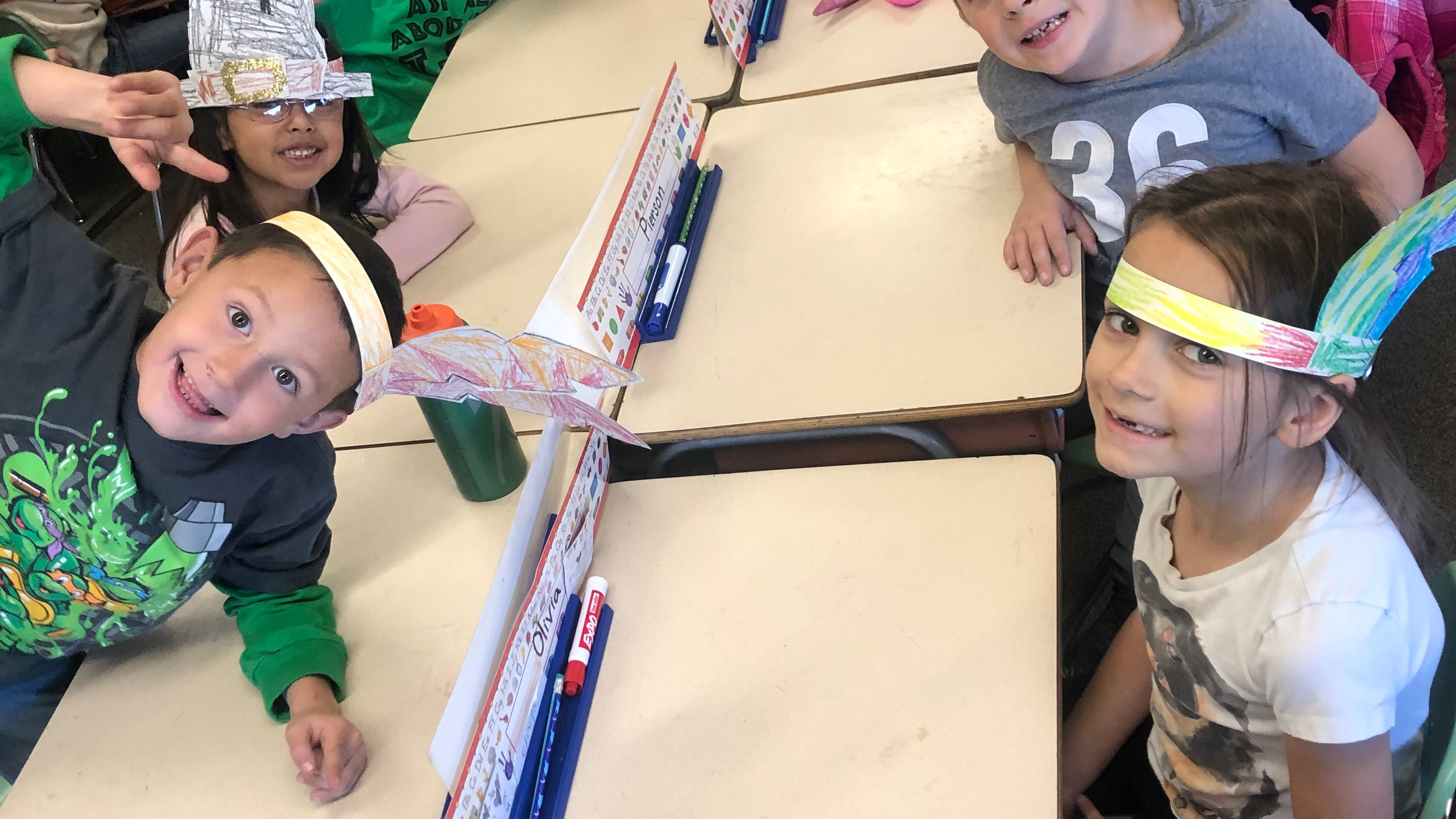 PES students smile for the camera as they learn about Thanksgiving.