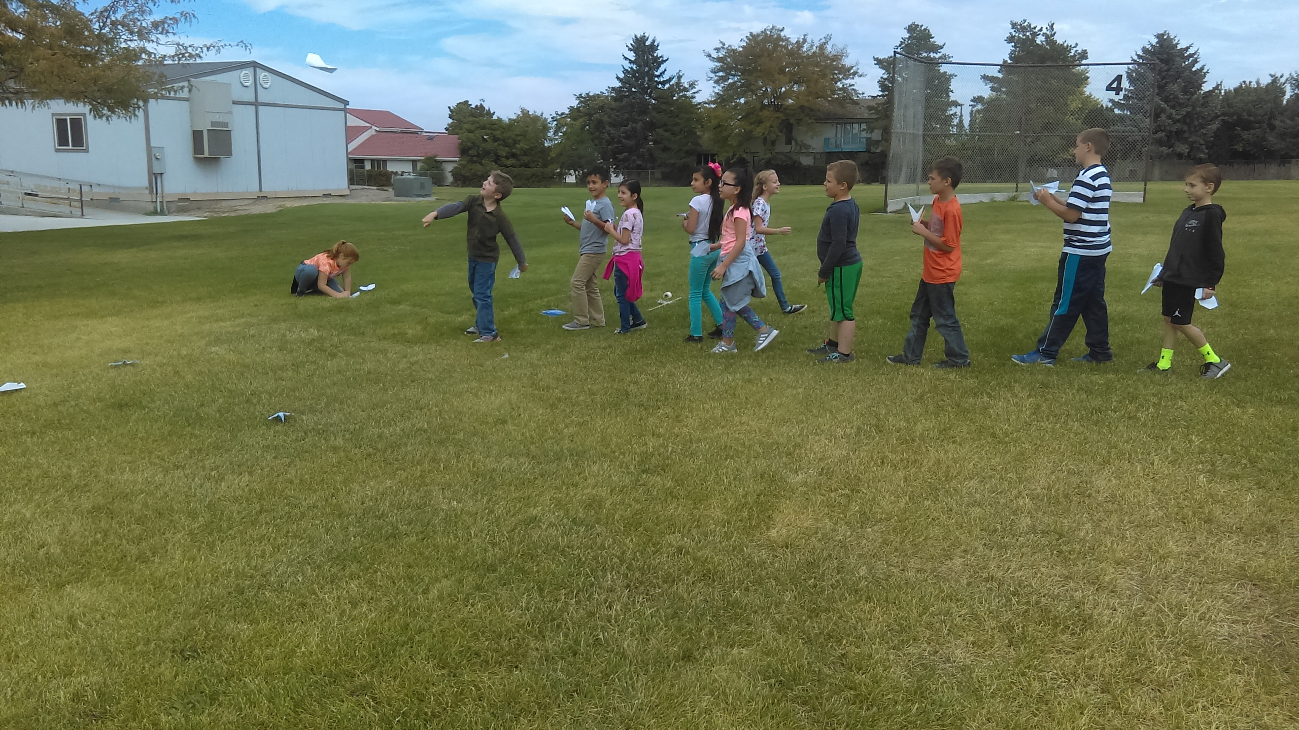 PES Students throw their paper airplanes to see who's goes farther.