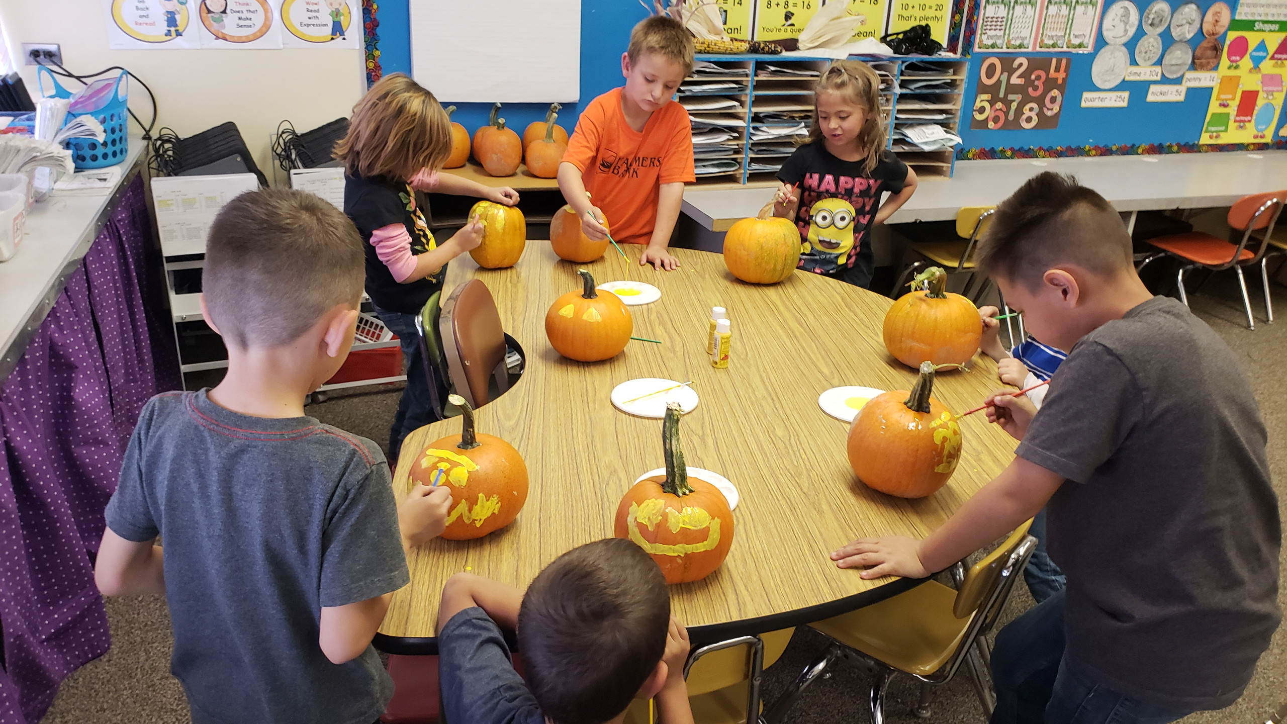 PES Students paint pumpkins in class.