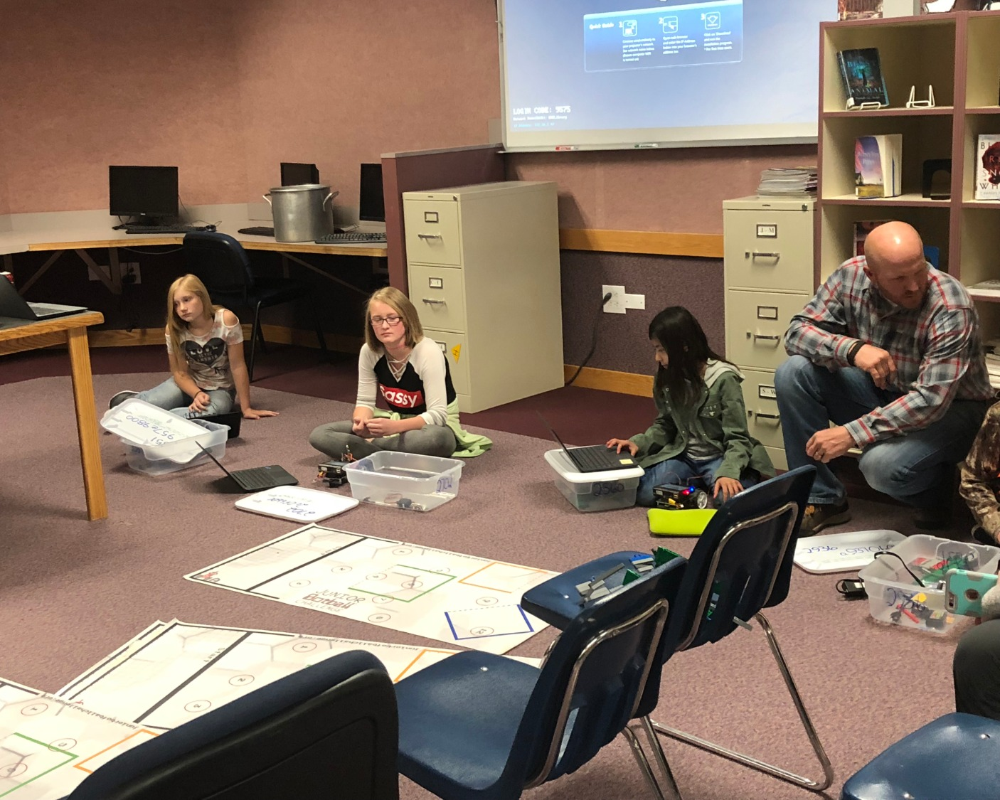 6th Grade students showcase the advancement of their robotics class to the school board.