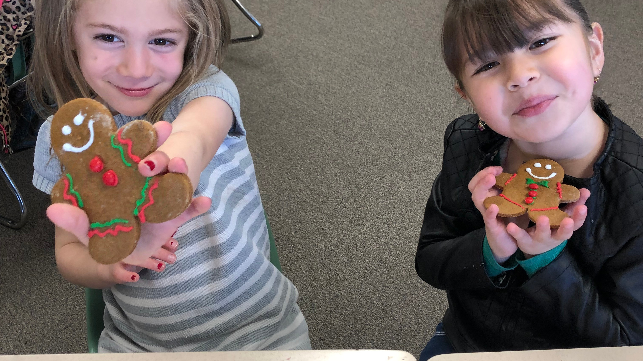 All smiles in this kindergarten class as they take their gingerbread man treat.