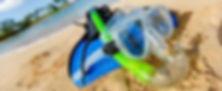 Snorkel and fins on beach in Rarotonga