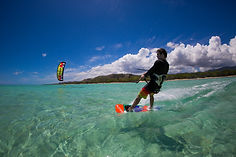 man kitesurfing on flat water in Rarotonga