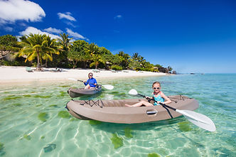 Mother and daughter kayaking on lagon in Rarotonga