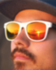 Man with a moustache wearing Moana Road sunglasses in Rarotonga