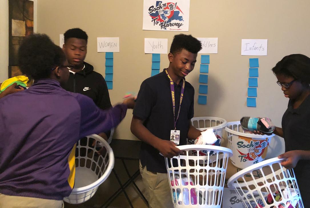 Volunteers counting and sorting socks