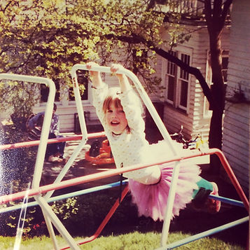 Amy G baby picture awkward little girl on a jungle gym tutu