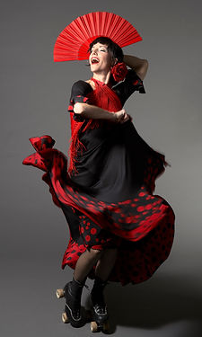 Amy G cabaret comedian dancing in Flamenco dress and rollerskates with fan photo by Jeff Cate at La Soiree Union Square Theatre NYC